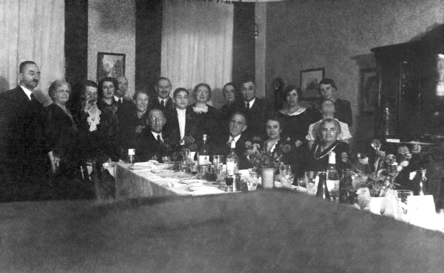 Werner (in the middle in a white shirt) during his Bar Mitzva party. Third from the right - Werner's father, second from the right (sitting) - his mother. Erna, Werner's sister, leans her head to the back.